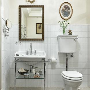 На фото: ванная комната в стиле современная классика с раздельным унитазом, белой плиткой, керамической плиткой, белыми стенами и консольной раковиной с