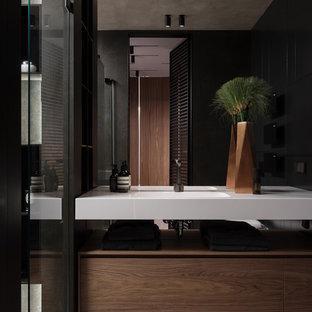 Создайте стильный интерьер: ванная комната в современном стиле с плоскими фасадами, монолитной раковиной, серым полом, белой столешницей и темными деревянными фасадами - последний тренд