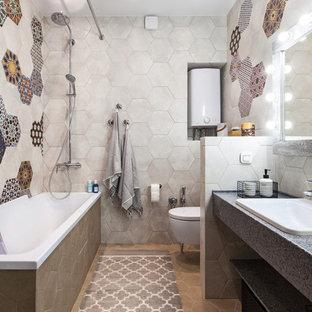 Свежая идея для дизайна: ванная комната в средиземноморском стиле с открытыми фасадами, накладной ванной, душем над ванной, инсталляцией, разноцветной плиткой, цементной плиткой, душевой кабиной, накладной раковиной, бежевым полом, шторкой для душа и серой столешницей - отличное фото интерьера