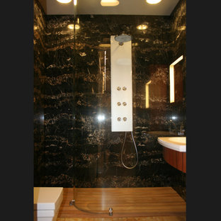 Bathroom - mid-sized contemporary 3/4 black tile and stone slab limestone floor and yellow floor bathroom idea in Moscow with flat-panel cabinets, medium tone wood cabinets, a one-piece toilet, black walls, a console sink, solid surface countertops and white countertops