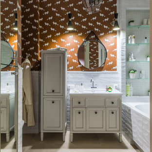 Design ideas for a mid-sized transitional 3/4 bathroom in Other with recessed-panel cabinets, beige cabinets, an alcove tub, white tile, orange walls, an undermount sink, beige floor, white benchtops, a single vanity, a built-in vanity and wallpaper.
