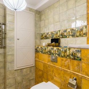 Foto de cuarto de baño romántico con sanitario de pared, baldosas y/o azulejos amarillos y suelo amarillo