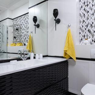 На фото: ванная комната в современном стиле с монолитной раковиной, белым полом, белой столешницей, черными фасадами, инсталляцией, разноцветной плиткой, серой плиткой и белыми стенами с