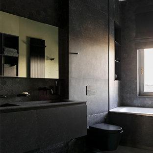 На фото: большая ванная комната в современном стиле с плоскими фасадами, черными фасадами, накладной ванной, душем в нише, писсуаром, черной плиткой, керамогранитной плиткой, черными стенами, полом из керамогранита, душевой кабиной, врезной раковиной, черным полом и черной столешницей с