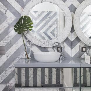 На фото: ванная комната в стиле современная классика с инсталляцией, серой плиткой, плоскими фасадами, мраморной плиткой, настольной раковиной, серым полом и серой столешницей