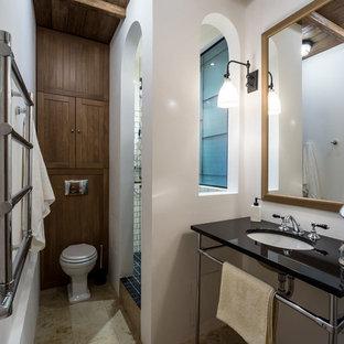 На фото: ванная комната в стиле кантри с раздельным унитазом, белыми стенами, душевой кабиной, врезной раковиной и бежевым полом с