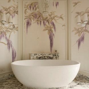 На фото: ванные комнаты в стиле современная классика с отдельно стоящей ванной, мраморным полом и белым полом