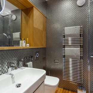 Design ideas for a contemporary shower room in Other with flat-panel cabinets, white cabinets, a wall mounted toilet, metal tiles, medium hardwood flooring and a wall-mounted sink.