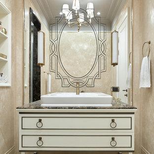 Идея дизайна: ванная комната в стиле современная классика с бежевыми фасадами, бежевой плиткой, плиткой из травертина, полом из травертина, настольной раковиной, бежевым полом и коричневой столешницей