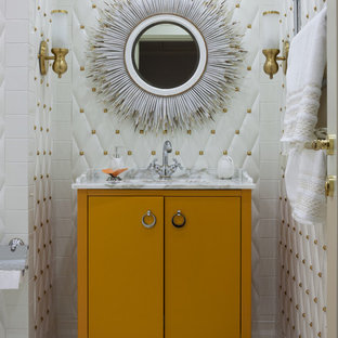This is an example of a classic ensuite bathroom in Moscow with flat-panel cabinets, orange cabinets, white tiles, white walls, marble flooring, a submerged sink, marble worktops and grey floors.