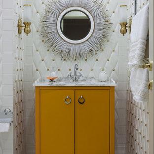 На фото: главные ванные комнаты в стиле современная классика с плоскими фасадами, оранжевыми фасадами, белой плиткой, белыми стенами, мраморным полом, врезной раковиной, мраморной столешницей и серым полом