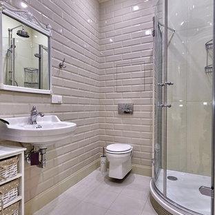 Новые идеи обустройства дома: ванная комната в современном стиле с угловым душем, инсталляцией, плиткой кабанчик, душевой кабиной, подвесной раковиной и бежевой плиткой