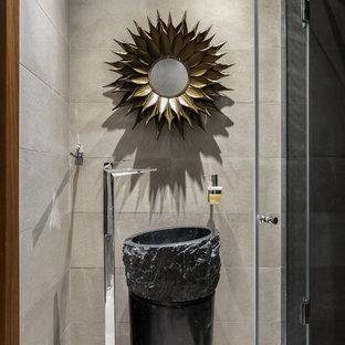 На фото: ванные комнаты в стиле лофт с серой плиткой, душевой кабиной, серым полом, душем в нише, раковиной с пьедесталом и душем с распашными дверями