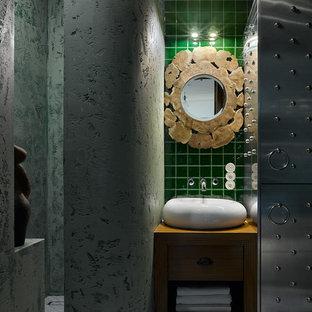 Свежая идея для дизайна: ванная комната в стиле фьюжн с плоскими фасадами, коричневыми фасадами, зеленой плиткой, душевой кабиной, настольной раковиной, серым полом, коричневой столешницей и зелеными стенами - отличное фото интерьера