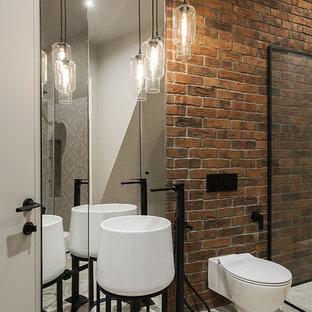 Стильный дизайн: ванная комната в стиле лофт с коричневыми стенами, душевой кабиной, монолитной раковиной и серым полом - последний тренд
