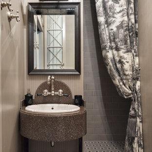 Idee per una piccola stanza da bagno con doccia tradizionale con doccia alcova, piastrelle grigie, lavabo da incasso, top in superficie solida e pareti marroni