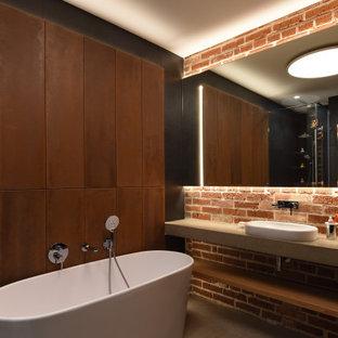 На фото: главная ванная комната среднего размера в стиле лофт с плоскими фасадами, коричневыми фасадами, отдельно стоящей ванной, красной плиткой, терракотовой плиткой, коричневыми стенами, бетонным полом, столешницей из бетона, серым полом, открытым душем, серой столешницей, угловым душем и настольной раковиной с