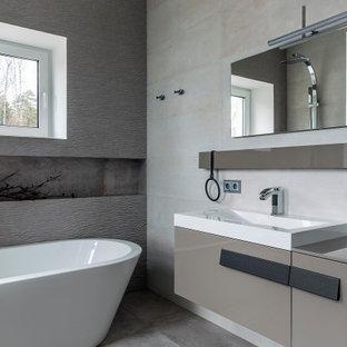Свежая идея для дизайна: главная ванная комната в современном стиле с плоскими фасадами, серыми фасадами, отдельно стоящей ванной, серой плиткой, накладной раковиной, серым полом, серой столешницей, тумбой под одну раковину и подвесной тумбой - отличное фото интерьера
