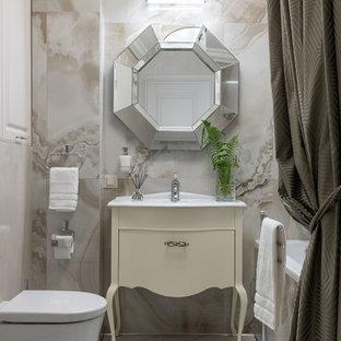 Пример оригинального дизайна: главная ванная комната среднего размера в стиле неоклассика (современная классика) с бежевыми фасадами, гидромассажной ванной, душем над ванной, инсталляцией, бежевой плиткой, керамогранитной плиткой, полом из керамогранита, консольной раковиной, бежевым полом, шторкой для ванной, белой столешницей и плоскими фасадами