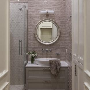 На фото: ванная комната в стиле неоклассика (современная классика) с фасадами с утопленной филенкой, серыми фасадами, угловым душем, душевой кабиной, настольной раковиной, коричневым полом, душем с распашными дверями, белой столешницей, серой плиткой, плиткой кабанчик и темным паркетным полом с
