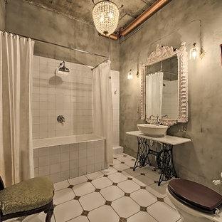 На фото: главная ванная комната в стиле лофт с душем над ванной, настольной раковиной, шторкой для душа, накладной ванной, белой плиткой, серыми стенами и разноцветным полом с
