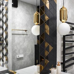 На фото: ванная комната в современном стиле с серыми стенами и раковиной с несколькими смесителями с