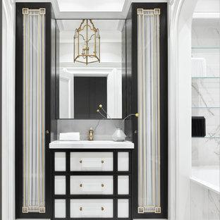 На фото: ванная комната в стиле современная классика с ванной в нише, белыми стенами, белым полом, белой столешницей, тумбой под одну раковину и напольной тумбой с