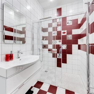 Exempel på ett mellanstort modernt vit vitt badrum med dusch, med släta luckor, vita skåp, en dusch i en alkov, röd kakel, vit kakel, porslinskakel, klinkergolv i porslin, ett integrerad handfat, flerfärgat golv och dusch med gångjärnsdörr