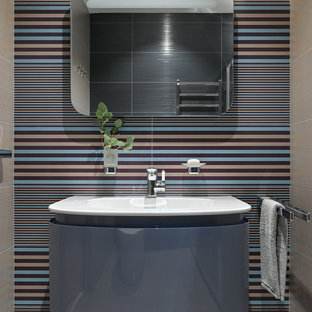 Inspiration for a large contemporary bathroom in Moscow with flat-panel cabinets, blue cabinets, a console sink, an alcove shower, blue tiles, ceramic tiles and ceramic flooring.