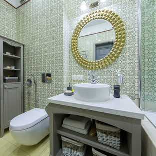 Inspiration for a transitional master green tile tub/shower combo remodel in Moscow with open cabinets, gray cabinets, a wall-mount toilet, a vessel sink and green walls