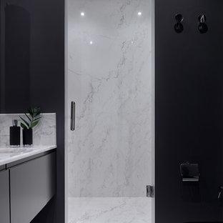 Новые идеи обустройства дома: ванная комната в современном стиле с душем в нише, врезной раковиной, мраморной столешницей, душем с распашными дверями, плоскими фасадами, серыми стенами, черными фасадами и душевой кабиной