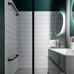 На фото: ванная комната в современном стиле с плоскими фасадами, белыми фасадами, душем в нише, зелеными стенами, душевой кабиной, серым полом и тумбой под одну раковину