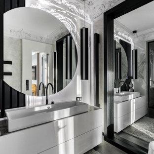 Идея дизайна: ванная комната среднего размера в современном стиле с тумбой под одну раковину, плоскими фасадами, серыми фасадами, серой плиткой, душевой кабиной, настольной раковиной, серым полом, серой столешницей и встроенной тумбой