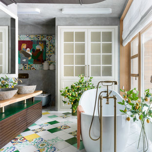 Inspiration for an eclectic master bathroom in Moscow with medium wood cabinets, a freestanding tub, grey walls, a vessel sink, wood benchtops, multi-coloured floor, beige benchtops and flat-panel cabinets.