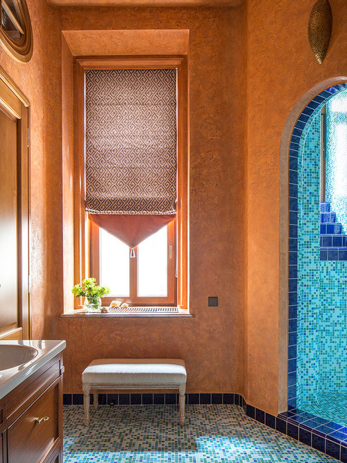 Bathroom with blue tiles and orange walls ideas designs for Blue and orange bathroom