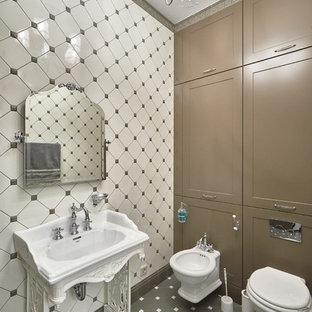 На фото: ванная комната в стиле современная классика с биде, бежевой плиткой и консольной раковиной