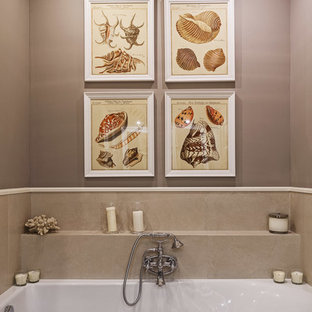 This is an example of a medium sized traditional bathroom in Moscow with an alcove bath, grey tiles, porcelain tiles, grey walls, solid surface worktops, recessed-panel cabinets, white cabinets, a wall mounted toilet, porcelain flooring, a built-in sink, beige floors, a hinged door and beige worktops.