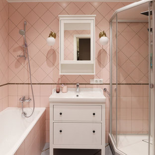 Inspiration for a medium sized contemporary ensuite bathroom in Moscow with flat-panel cabinets, white cabinets, an alcove bath, a corner shower, pink tiles, ceramic tiles, ceramic flooring, grey floors, a sliding door and an integrated sink.
