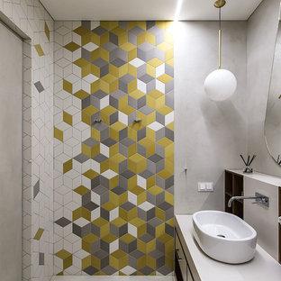 На фото: ванная комната в современном стиле с плоскими фасадами, белой столешницей, разноцветной плиткой и настольной раковиной