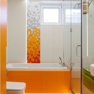 Bathroom - contemporary master orange tile orange floor bathroom idea in Saint Petersburg with flat-panel cabinets, green cabinets, a wall-mount toilet, white walls, a vessel sink and a hinged shower door