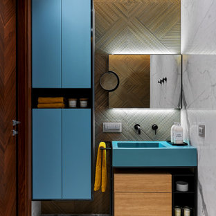 Photo of a contemporary bathroom in Moscow with turquoise cabinets, an integrated sink, grey floor, a single vanity and a freestanding vanity.