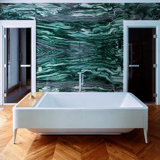 Inspiration for a contemporary master medium tone wood floor claw-foot bathtub remodel in Yekaterinburg with green walls