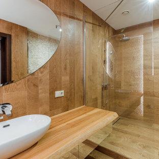 Пример оригинального дизайна: ванная комната в белых тонах с отделкой деревом в современном стиле с плоскими фасадами, настольной раковиной, душем в нише, коричневой плиткой, душевой кабиной, коричневым полом, коричневой столешницей и коричневыми стенами
