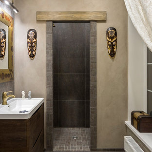 Imagen de cuarto de baño con ducha, de estilo zen, de tamaño medio, con armarios con paneles lisos, baldosas y/o azulejos grises, baldosas y/o azulejos de porcelana, paredes beige, suelo de baldosas de porcelana, suelo gris, ducha abierta, ducha empotrada, lavabo integrado, puertas de armario de madera en tonos medios y encimeras blancas