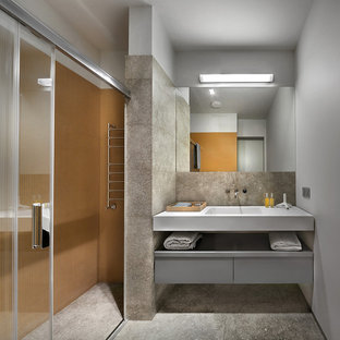 Inspiration for a contemporary shower room bathroom in Yekaterinburg with flat-panel cabinets, grey cabinets, an alcove shower, orange tiles, grey tiles, white walls, an integrated sink and a sliding door.