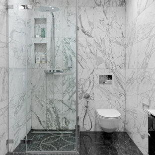 На фото: ванная комната среднего размера в современном стиле с инсталляцией, белой плиткой, керамогранитной плиткой, полом из мозаичной плитки, душевой кабиной, черным полом, душем с распашными дверями и угловым душем с