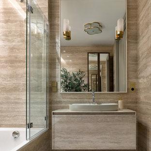 На фото: маленькая главная ванная комната в современном стиле с плоскими фасадами, серыми фасадами, душем над ванной, серой плиткой, настольной раковиной, серым полом, серой столешницей, тумбой под одну раковину и подвесной тумбой