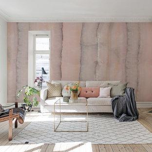 Inspiration för minimalistiska separata vardagsrum, med ett finrum, rosa väggar, ljust trägolv, en öppen hörnspis, en spiselkrans i sten och beiget golv