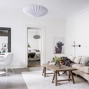 Inspiration för minimalistiska allrum med öppen planlösning, med vita väggar och grått golv