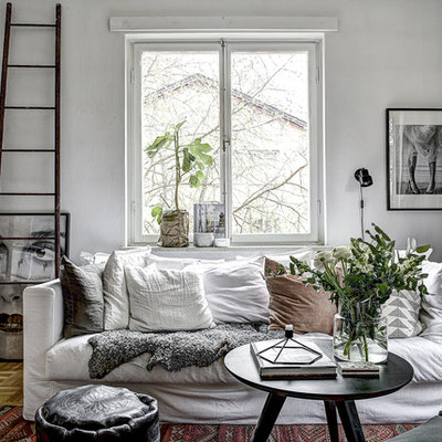 Living room - mid-sized scandinavian formal and open concept light wood floor living room idea in Stockholm with white walls